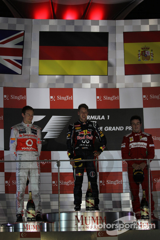 Podium: race winner Sebastian Vettel, Red Bull Racing, second place Jenson Button, McLaren Mercedes, third place Fernando Alonso, Scuderia Ferrari