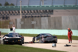 Heavy crash for #00 Ferrari of Houston 458TP: Owen Kratz, driver coach Anthony Lazzaro out of the car, cars try to avoid the debris
