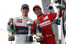 Kamui Kobayashi, Sauber celebrates his third position on the podium with second placed Felipe Massa, Ferrari