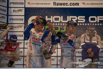 Alexander Wurz and Kazuki Nakajima celebrate
