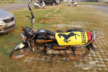 A motorbike in the circuit car park