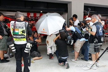 Lewis Hamilton, McLaren surrounded by photographers in the pits