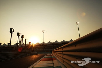 Sun sets at the pit lane entrance