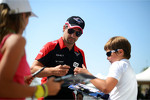 Timo Glock, Marussia F1 Team signs autographs for the fans