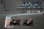 Romain Grosjean, Lotus F1 Team and Sebastian Vettel, Red Bull Racing