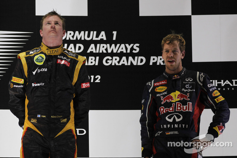 1st place Kimi Raikkonen, Lotus Renault F1 Team with Sebastian Vettel, Red Bull Racing