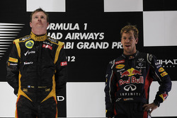 1st place Kimi Raikkonen, Lotus Renault F1 Team with Sebastian Vettel, Red Bull Racing