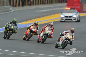 A group of riders start from the pitlane