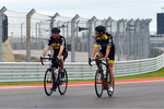 Martin Brundle, Sky Sports Commentator and Jenson Button, McLaren ride the circuit on their bikes