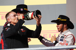 Race winner Lewis Hamilton, McLaren celebrates on the podium with Martin Whitmarsh, McLaren Chief Executive Officer