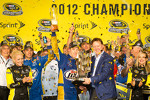 Championship victory lane: 2012 NASCAR Sprint Cup Series champion Brad Keselowski, Penske Racing Dodge accepts the Sprint Cup