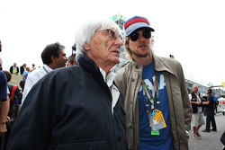 Owen Wilson, with Bernie Ecclestone, CEO Formula One Group, on the grid