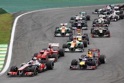 Jenson Button, McLaren leads Mark Webber, Red Bull Racing at the start of the race
