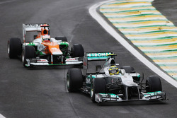 Nico Rosberg, Mercedes AMG F1 leads Paul di Resta, Sahara Force India