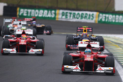 Fernando Alonso, Ferrari leads Felipe Massa, Ferrari and Mark Webber, Red Bull Racing