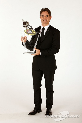 Jeff Gordon with the tenth place trophy