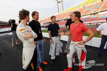 Michael Schumacher, Sebastian Vettel and Romain Grosjean watch practice