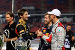Second place Romain Grosjean and first place Michael Schumacher, Sebastian Vettel