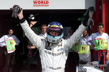 Mika Hakkinen celebrates pole position