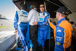 Memo Rojas, Scott Pruett and Charlie Kimball prepare to celebrate with one lap to go