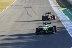 Giedo van der Garde, Caterham CT03 leads Mark Webber, Red Bull Racing RB9