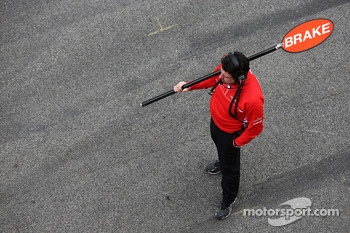 Marussia F1 Team pit stop lollipop man