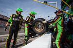 Stewart-Haas Racing Chevrolet crew members after a pit stop