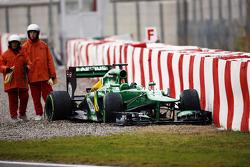 Giedo van der Garde, Caterham CT03 off the circuit at the final corner