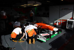 Mechanics work on the Sahara Force India F1 VJM06