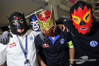 Volkswagen Motorsport team members in Lucha Libre masks