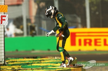Giedo van der Garde, Caterham F1 Team climbs across the tyre barrier after stopping in in the second practice session