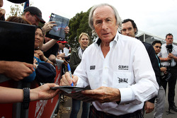 Jackie Stewart, signs autographs for the fans