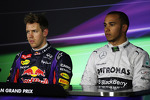 (L to R): Pole sitter Sebastian Vettel, Red Bull Racing and Lewis Hamilton, Mercedes AMG F1 in the FIA Press Conference
