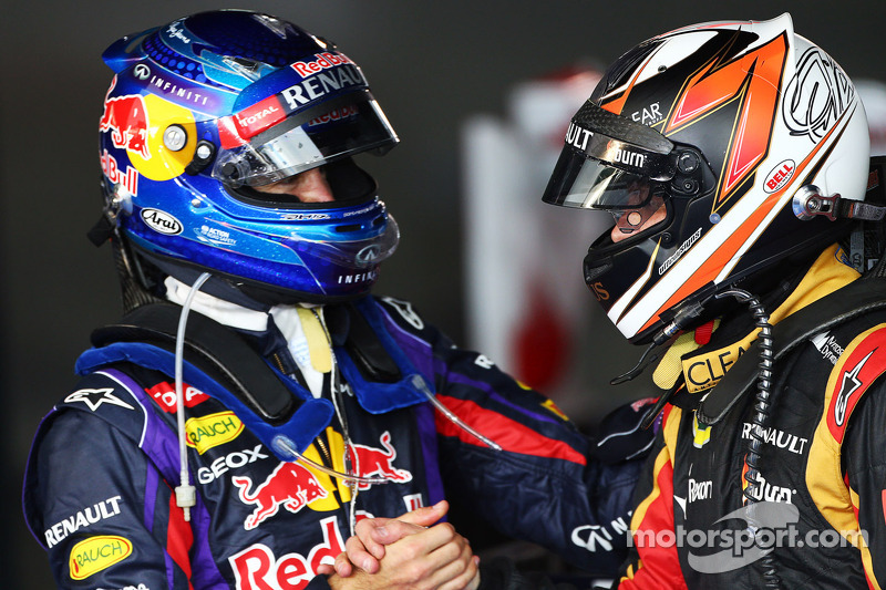 Race winner Kimi Raikkonen, Lotus F1 Team celebrates in parc ferme with Sebastian Vettel, Red Bull Racing