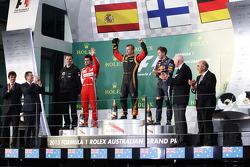 The podium, Ferrari, second; Jenson Button, McLaren, race winner; Fernando Alonso, Ferrari, third