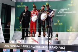 The podium, Renault Race Engineer; Fernando Alonso, Ferrari, second; Jenson Button, McLaren, race winner; Fernando Alonso, Ferrari, third