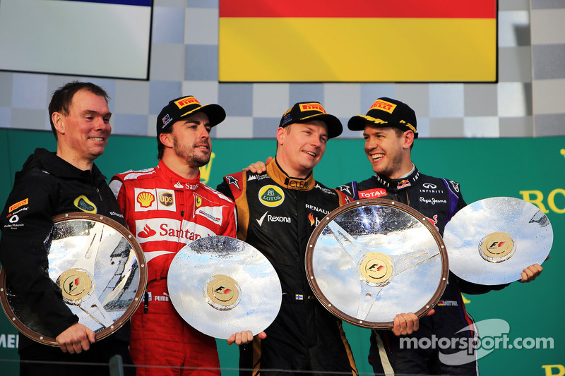 The podium, Renault Race Engineer; Fernando Alonso, Ferrari, second; Kimi Raikkonen, Lotus F1 Team, race winner; Sebastian Vettel, Red Bull Racing, third