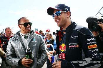 (L to R): Lewis Hamilton, Mercedes AMG F1 and Sebastian Vettel, Red Bull Racing on the drivers parade