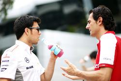 Sergio Perez, McLaren with Pedro De La Rosa, Ferrari Development Driver