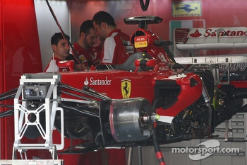 Ferrari F138 is prepared in the pits