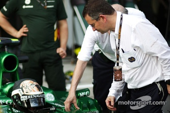 Dr Ian Roberts, FIA Doctor watches a practice extraction using the Caterham CT03