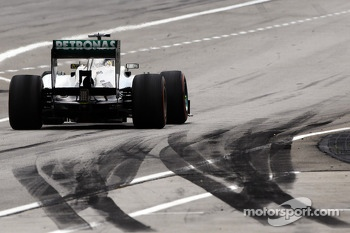 Lewis Hamilton, Mercedes AMG F1 W04 passes tyre marks at the pit exit