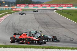 Jules Bianchi, Marussia F1 Team MR02 and Lewis Hamilton, Mercedes AMG F1 W04