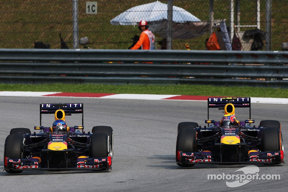 Sebastian Vettel, Red Bull Racing RB9 and team mate Mark Webber, Red Bull Racing RB9 battle for the lead of the race