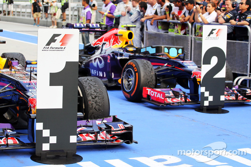 The Red Bull Racing RB9s of race winner Sebastian Vettel, Red Bull Racing and team mate Mark Webber, Red Bull Racing in parc ferme.