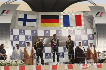 Podium: Kimi Raikkonen, Lotus F1 Team, second; Sebastian Vettel, Red Bull Racing, race winner; Romain Grosjean, Lotus F1 Team, third