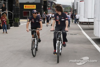 Daniel Ricciardo, Scuderia Toro Rosso rides his bike through the paddock