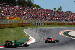 Max Chilton, Marussia F1 Team MR02 leads Charles Pic, Caterham CT03