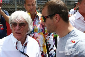 (L to R): Bernie Ecclestone, CEO Formula One Group, with Sebastien Loeb, Porsche AG on the grid