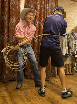 David Reynolds tries on some Texas style with Tim Slade